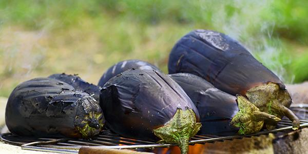 Aubergine roasting on a fire