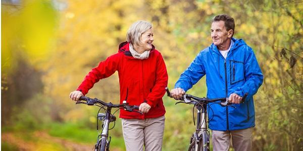 A couple spending time together while biking in the Forest of Bowland