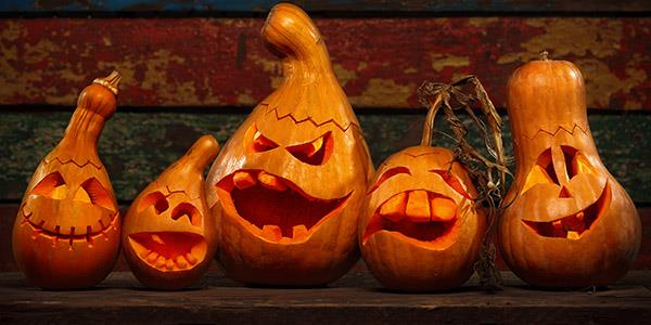 Funny Carved pumpkins on wooden table