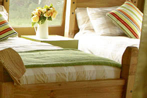 Sleep tight in a solid pine bed on a comfortable mattress