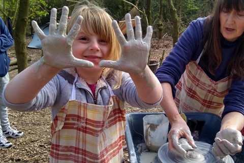 Kids will have fun getting hands on throwing clay on the pottery wheel